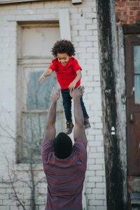 Parenting Plan dad throwing child in air