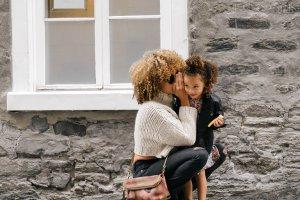 Parenting Plan Mum whispering to child