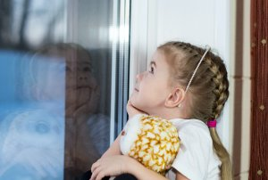 child hugging doll - child maintenance