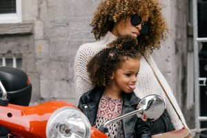 mum and daughter on moped